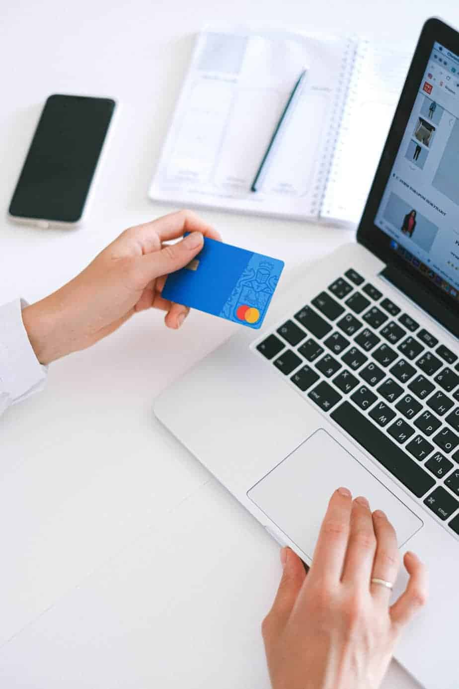 woman using credit card on website